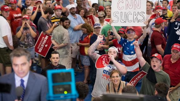 WEST COLUMBIA, SC - JUNE 25: People shout behind CNN reporter Jim Acosta before a campaign rally for South Carolina Governor Henry McMaster featuring President Donald Trump at Airport High School June 25, 2018 in West Columbia, South Carolina. (Photo by Sean Rayford/Getty Images)