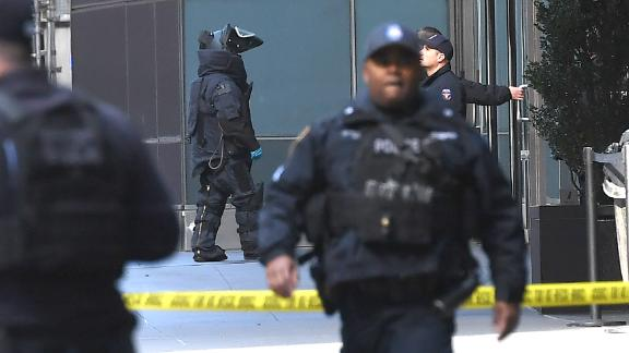 Police patrol outside the Time Warner Building on October 24, 2018 where a suspected explosive device was found in the building after it was delivered to CNN's New York bureau. - Suspected explosive devices were sent to former president Barack Obama, defeated presidential nominee Hillary Clinton and to a building housing CNN's New York bureau less than 24 hours apart and less than two weeks before key US midterm elections, officials confirmed Wednesday. The targeted Democrats are among the most high-profile political figures in the United States, which goes to the polls on November 6 in elections seen as a referendum on Republican President Donald Trump. (Photo by TIMOTHY A. CLARY / AFP)        (Photo credit should read TIMOTHY A. CLARY/AFP/Getty Images)