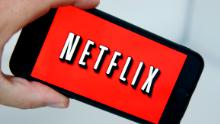 PARIS, FRANCE - OCTOBER 23:  In this photo illustration, the Netflix media service provider's logo is displayed on the screen of a smartphone on October 23, 2018 in Paris, France. The US video-on-demand company Netflix announced Monday it wants to raise an additional $ 2 billion to fund new productions. Netflix offers movies and television series on the Internet, the company has 137 million subscribers.