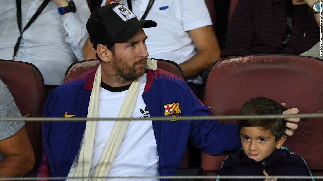 Lionel Messi watched his Barcelona side from the stands after fracturing his right arm at the weekend. The Catalan club announced that their star man, pictured here with his son, will likely miss three weeks of action.