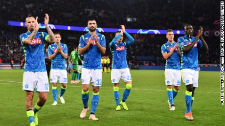 Napoli players applaud  fans after an impressive performance in the Champions League.