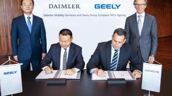 Geely and Daimler executives signed an initial agreement on a new ride-hailing joint venture on Wednesday at Daimler's headquarters in Stuttgart, Germany.