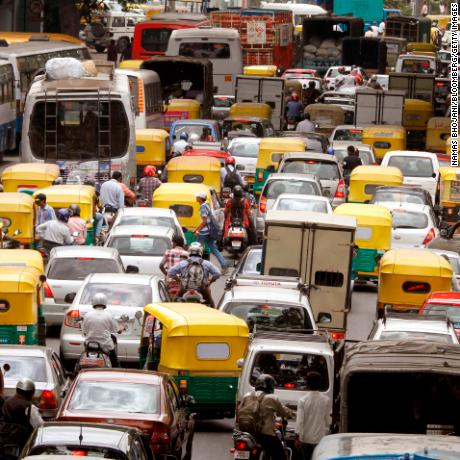 Traffic stands in a queue on Residency Road in downtown Bangalore, India, on Friday, June 22, 2012. The city's traffic jams make it the sixth-most painful worldwide for commuters and second-worst for parking after New Delhi, according to a 2011 survey of 20 cities by International Business Machines Corp.