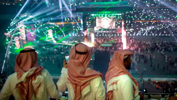 """Fans film the opening of the """"Greatest Royal Rumble"""" event in Jiddah, Saudi Arabia, Friday, April 27, 2018."""