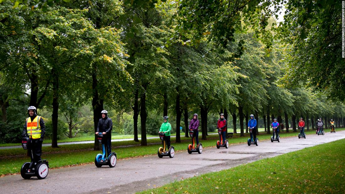 A Segway tour passes through Hanover, Germany. (Photo by Swen Pförtner/picture alliance via Getty Images)