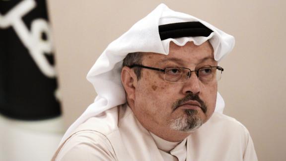 Jamal Khashoggi, looks on during a press conference in the Bahraini capital Manama, on December 15, 2014.