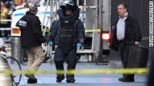 A member of the New York Police Department bomb squad is pictured outside the Time Warner Center in New York on Wednesday after a suspicious package was found inside.