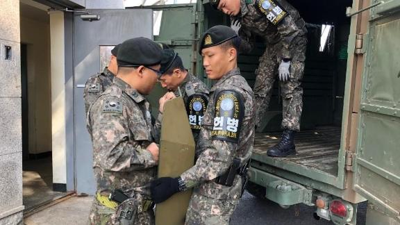 Soldiers remove military equipment from the Joint Security Area in the demilitarized zone that divides the two Koreas.