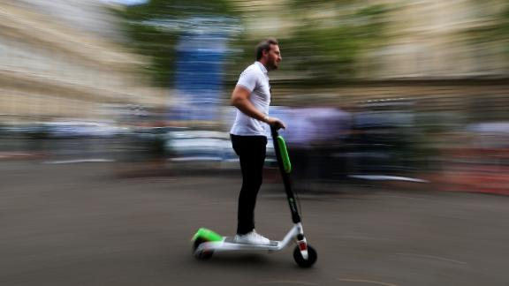 A man rides a dock-free electric scooter Lime-S by California-based bicycle sharing service Lime during a presentation of new alternative urban mobility options at Paris city hall, France, July 19, 2018. REUTERS/Gonzalo Fuentes