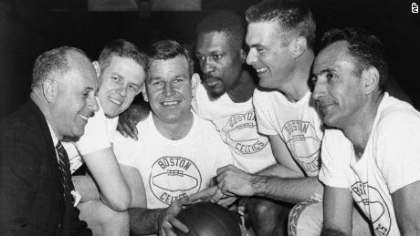 Bob Cousy, right, and Bill Russell pose for a team photo in 1963 with coach Red Auerbach.