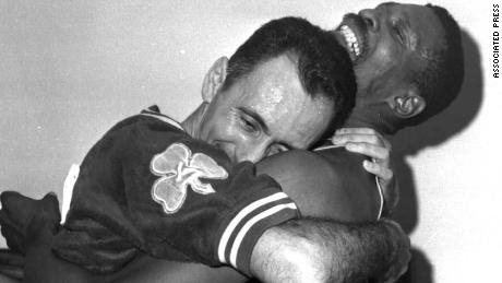 FILE -- Boston Celtics stars Bill Russell, right, and Bob Cousy hug after defeating the Los Angeles Lakers for their fifth consecutive NBA Championship, in Los Angeles, in this April 25, 1963 photo.On Wednesday night, May 26, 1999, the team Celtics finally honor Russell publicly when it rededicates his No. 6 alongside the 11 NBA championship banners Russell helped win. (AP Photo/File)