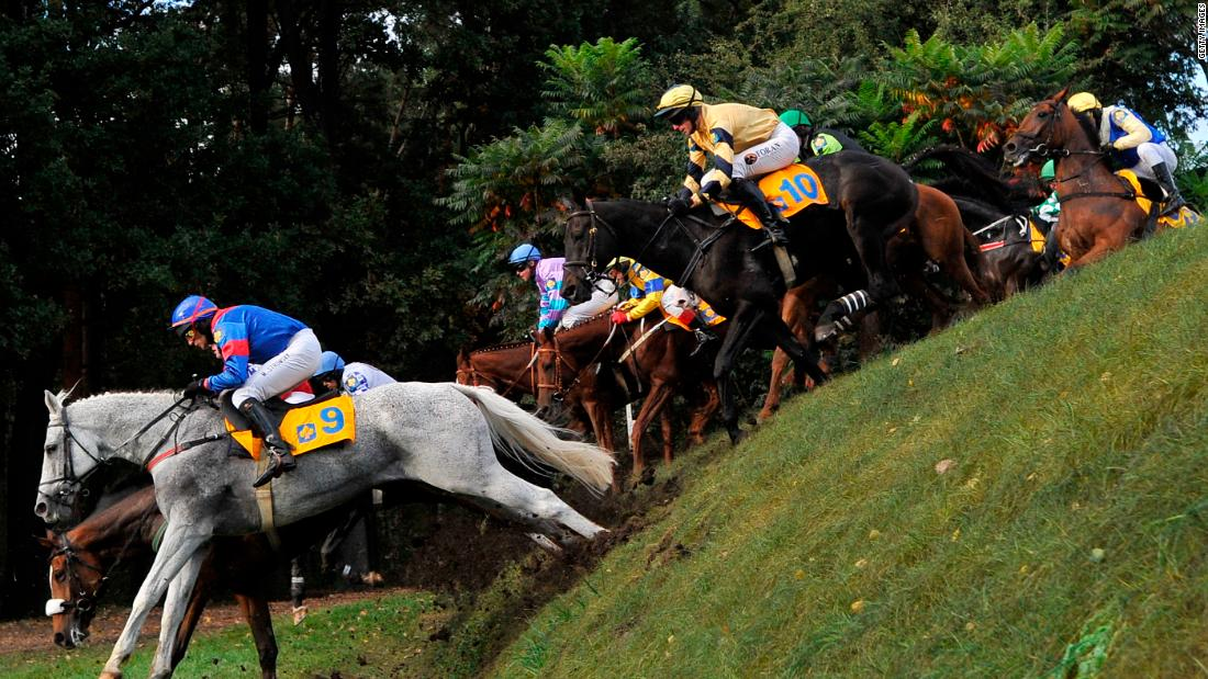 Jockeys compete at the Velka Pardubicka Steeplechase in Pardubice, Czech Republic. The annual race is not just the world's oldest cross-country horse race -- but also arguably the most difficult.