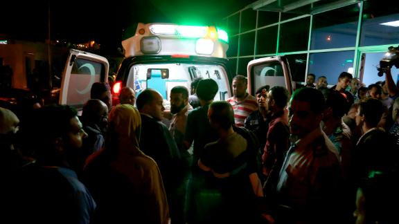 Residents and relatives of flood victims gather outside a hospital near the Dead Sea in Jordan Thursday, October 25, 2018.