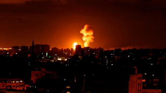 An explosion lights the sky during an Israeli airstrike Saturday in Gaza City.