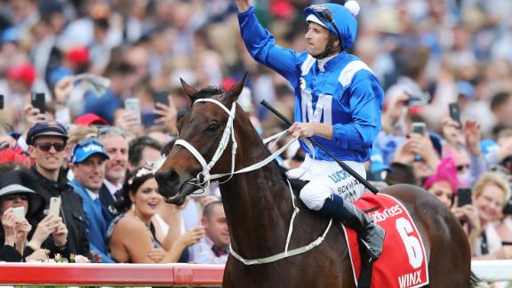 Jockey Hugh Bowman celebrates after guiding Winx to her record fourth Cox Plate at Moonee Valley in Melbourne, her 29th straight victory of a remarkable career.