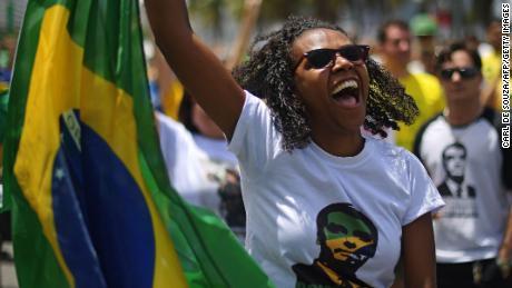 A supporter of Jair Bolsonaro takes part in a rally Sunday in Rio de Janeiro.