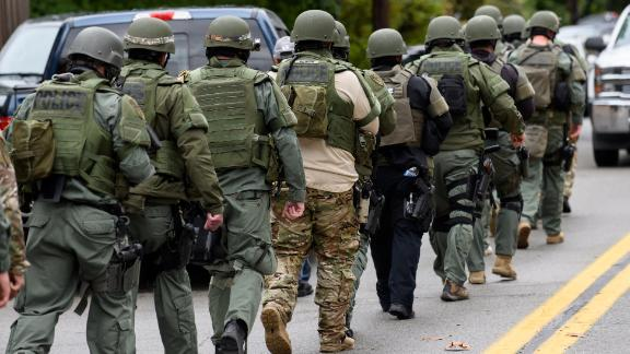 Rapid reaction SWAT members leave the scene of a mass shooting at the Tree of Life Synagogue in the Squirrel Hill neighborhood on October 27, 2018 in Pittsburgh, Pennsylvania.