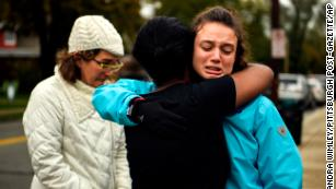 Kate Rothstein, left, looks on as Tammy Hepps hugs Simone Rothstein, 16, after multiple people were shot at The Tree of Life synagogue in Pittsburgh.