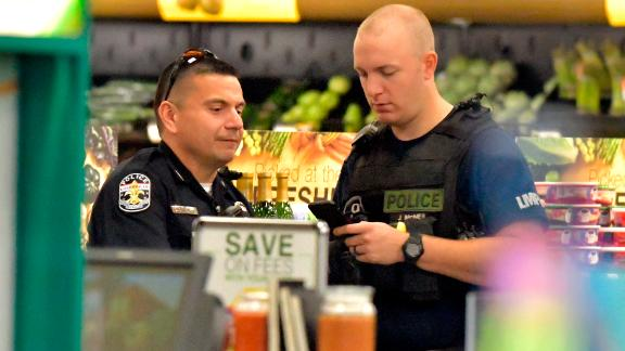 Members of the Louisville Metro Police Department talk inside a Kroger grocery in Jeffersontown, Kentucky following a shooting on Oct. 24, 2018.