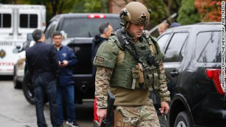 Law enforcement personnel respond to the scene of the synagogue shooting in Pittsburgh on Saturday.