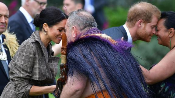 """Meghan and Harry receive a """"hongi"""" during welcoming ceremony at Government House in Wellington."""