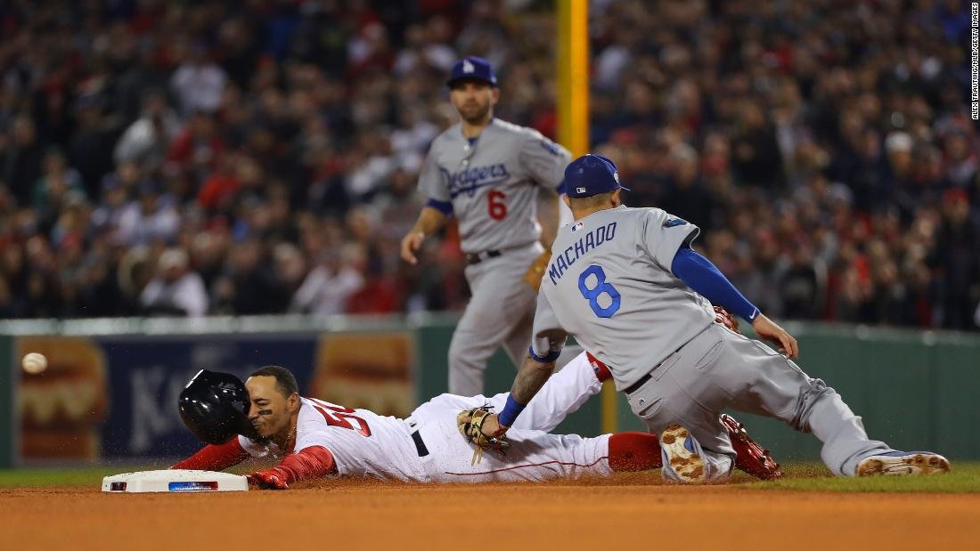 9127c7def Mookie Betts of the Boston Red Sox steals second base ahead of the tag from  Manny. Photos  In pictures  the 2018 World Series
