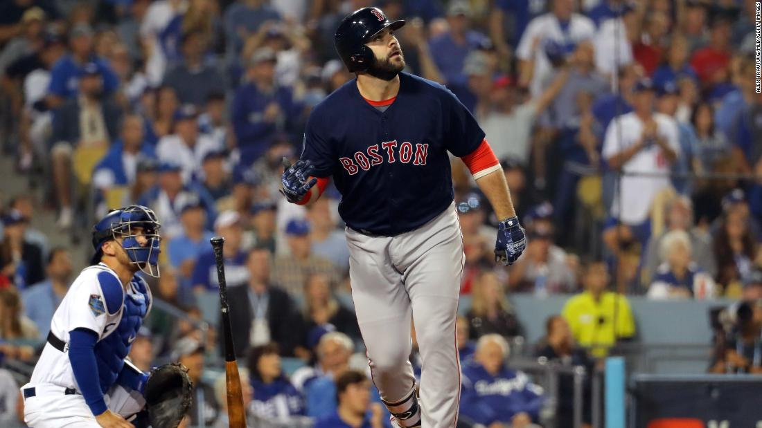 Mitch Moreland of the Red Sox hits a three-run home run in the seventh inning during Game 4. The Red Sox won the game 9-6 to take a 3-1 series lead.