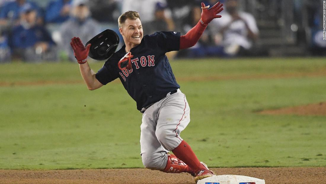 Brock Holt of the Red Sox slides into second base on a one-out double to left field in the ninth inning of Game 4 at Dodger Stadium on Saturday, October 27.