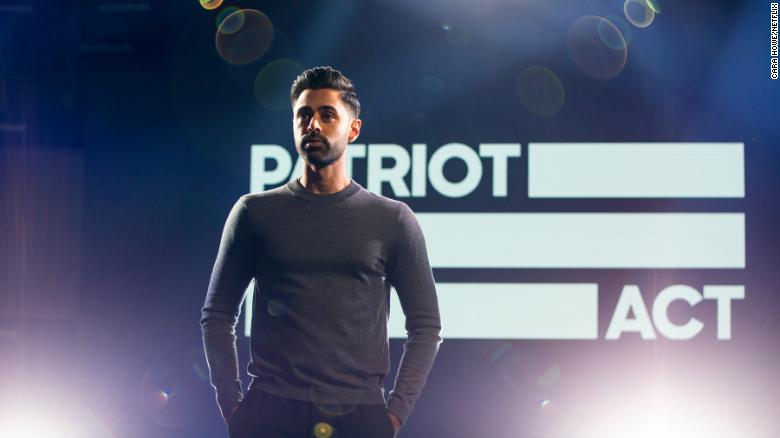 "Minhaj poses on the set of his Netflix show, ""Patriot Act."""