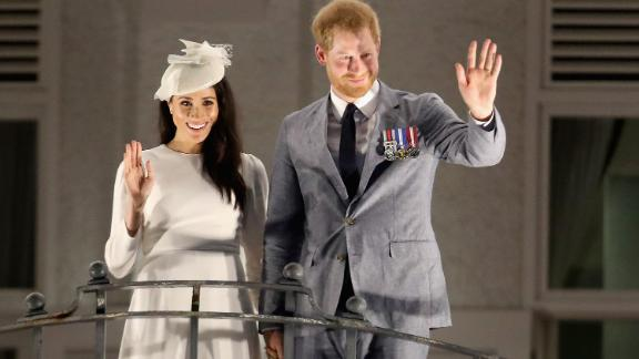 Harry and Meghan wave from the balcony of the Grand Pacific Hotel in Suva, Fiji, on Tuesday, October 23.