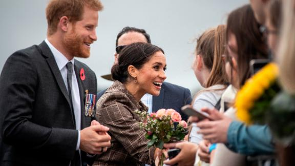 Britain's Prince Harry and Meghan, Duchess of Sussex, greet the crowd as they visit the newly unveiled UK war memorial and Pukeahu National War Memorial Park in in Wellington, New Zealand, on Sunday, October 28.