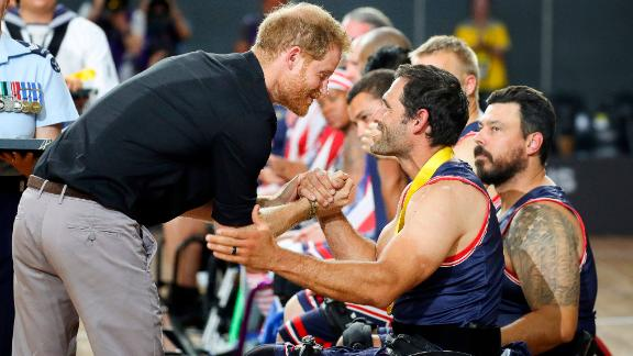 Prince Harry congratulates a member of the United States wheelchair basketball team after the team won the gold medal in the finals of the Invictus Games in Sydney on Saturday, October 27.