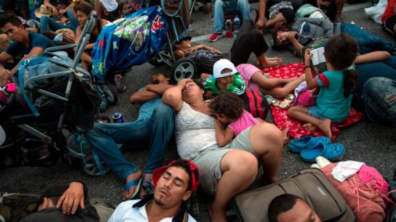 Members of a US-bound migrant caravan rest on a road between the Mexican states of Chiapas and Oaxaca after federal police briefly blocked them outside the town of Arriaga, Saturday, Oct. 27, 2018. Hundreds of Mexican federal officers carrying plastic shields had blocked the caravan from advancing toward the United States, after several thousand of the migrants turned down the chance to apply for refugee status and obtain a Mexican offer of benefits. (AP Photo/Rodrigo Abd)