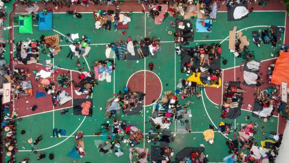 Migrants heading in a caravan to the United States rest on a basketball court in San Pedro Tapanatepec, Mexico. on Sunday, October 28.