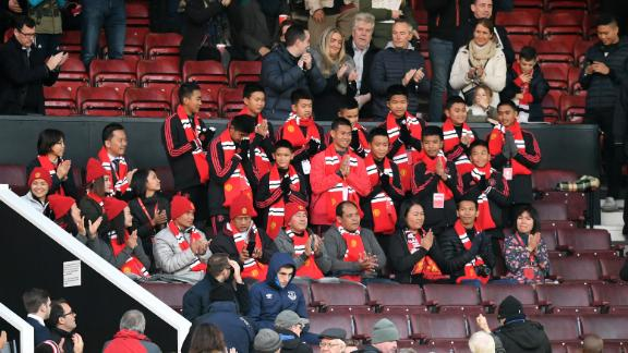 Members of the 'Wild Boars' soccer team attended a Premier League match between Manchester United and Everton FC at Old Trafford stadium in October 2018.