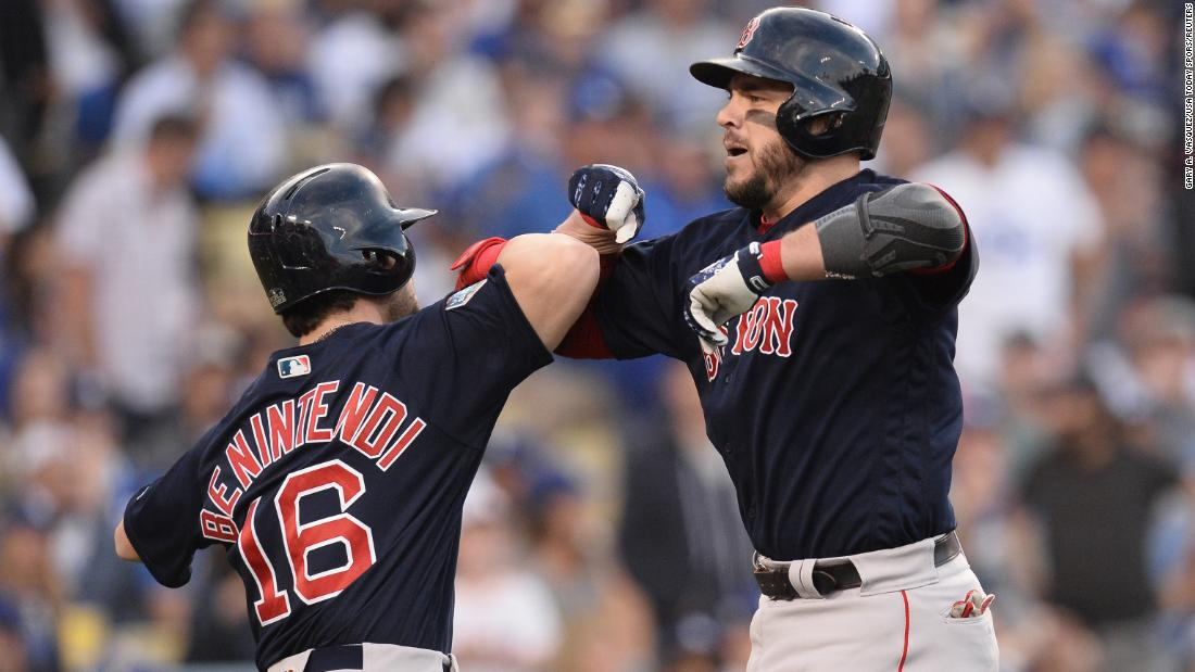 Red Sox first baseman Steve Pearce celebrates scoring with outfielder Andrew Benintendi after hitting a two-run home run in the first inning against Dodgers in Game 5.
