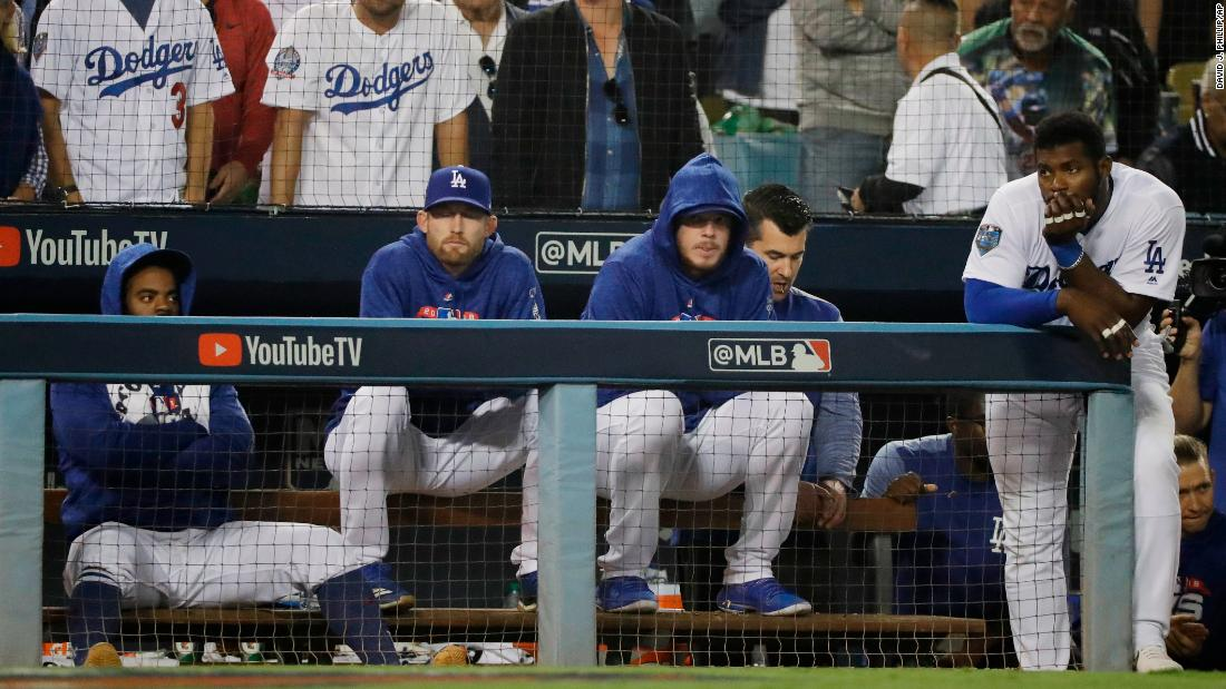The Los Angeles Dodgers watch the eighth inning of Game 5 from the dugout.