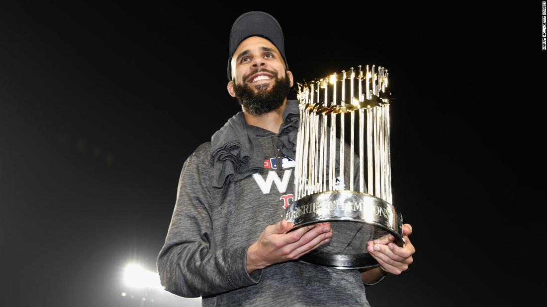 David Price of the Boston Red Sox poses with the World Series trophy after Boston's Game 5 win over the Los Angeles Dodgers.