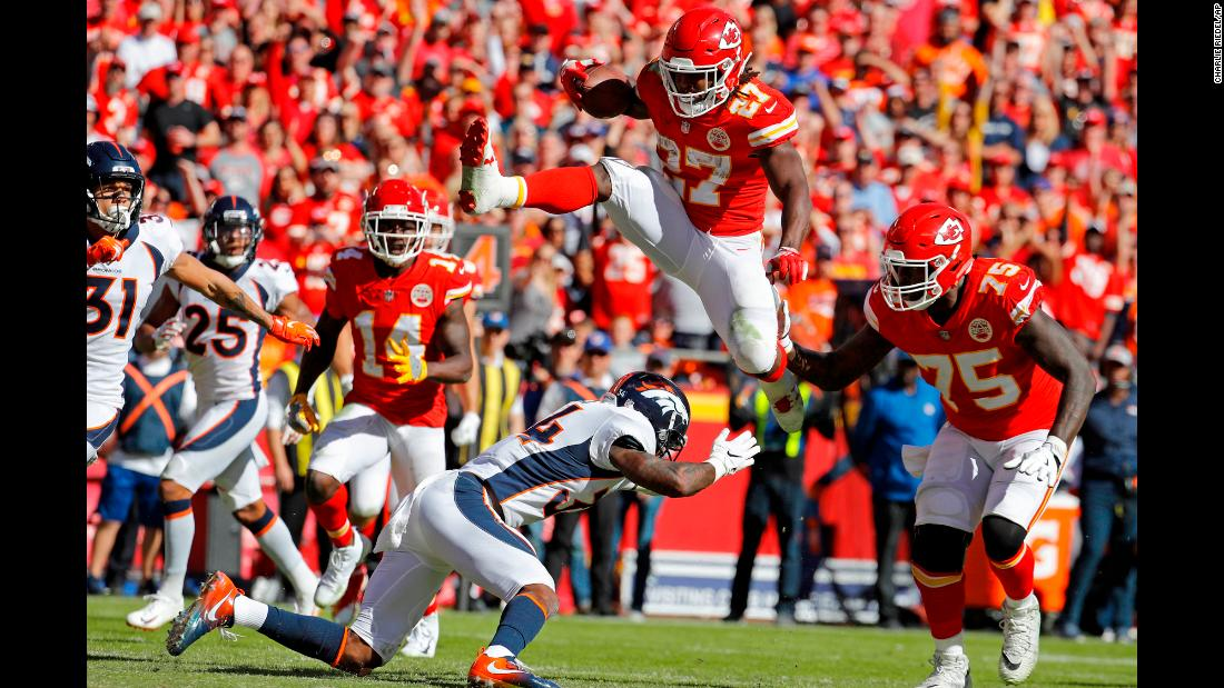 "Kansas City running back Kareem Hunt jumps over Denver safety Will Parks on his way to scoring a <a href=""https://twitter.com/NFL/status/1056623203865419776"" target=""_blank"">spectacular touchdown</a> on Sunday, October 28."