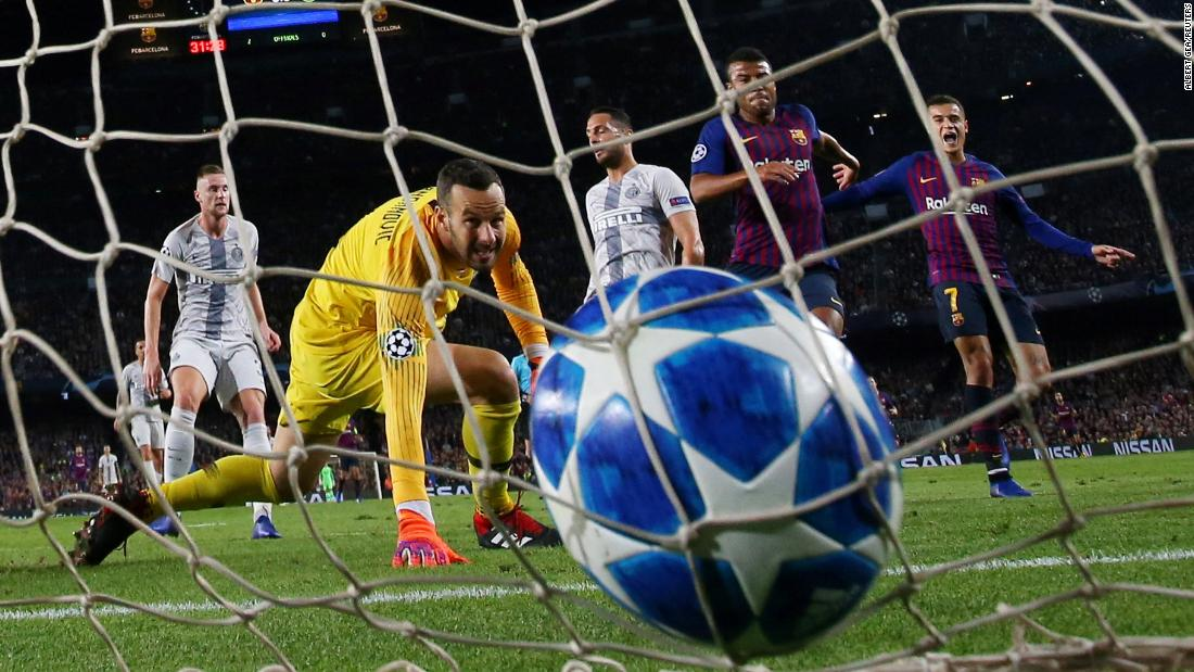 Inter Milan goalkeeper Samir Handanovic watches a goal slip past him during a Champions League match against Barcelona on Wednesday, October 24. Barcelona won 2-0.