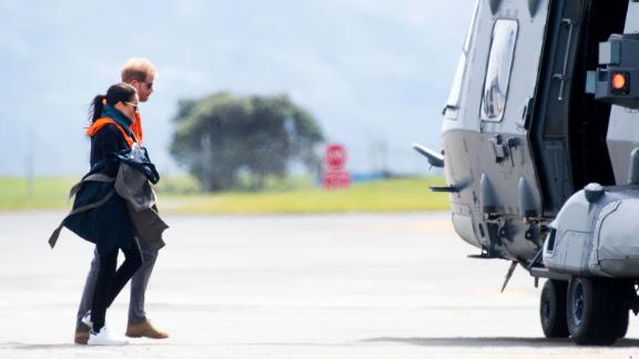 Britain's Prince Harry and Meghan, the Duchess of Sussex, arrive at the military terminal to board an Air Force NH90 helicopter that will take them to Tasman in Wellington on Monday, October 29.