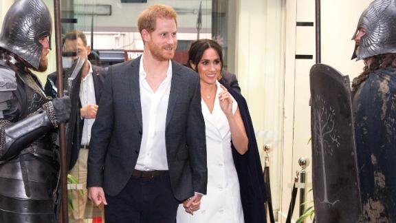 Britain's Prince Harry and Meghan Markle, Duchess of Sussex, arrive at Courtney Creative in Wellington, New Zealand, on Monday, October 29.