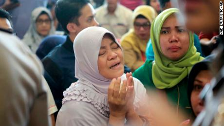 A relative of passengers prays as they and others wait for news about the Lion Air aircraft.