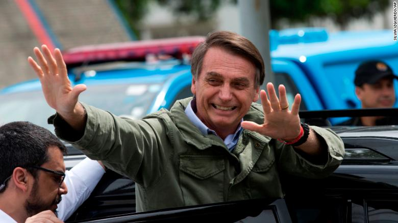 Jair Bolsonaro waves after voting in the presidential runoff election in Rio de Janeiro on October 28.