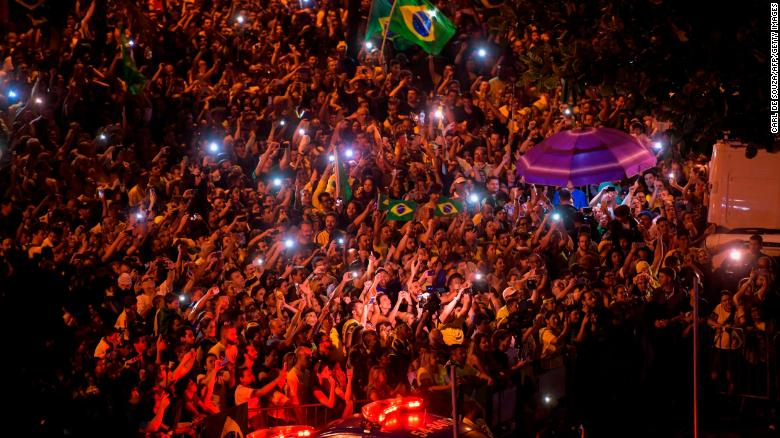 Supporters of far-right presidential candidate Jair Bolsonaro celebrate in Rio de Janeiro on Sunday.