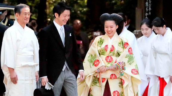 Japanese Princess Ayako, dressed in traditional ceremonial gown, and Japanese businessman Kei Moriya, arrive at Meiji Shrine for their wedding ceremony in Tokyo,  Oct. 29, 2018.
