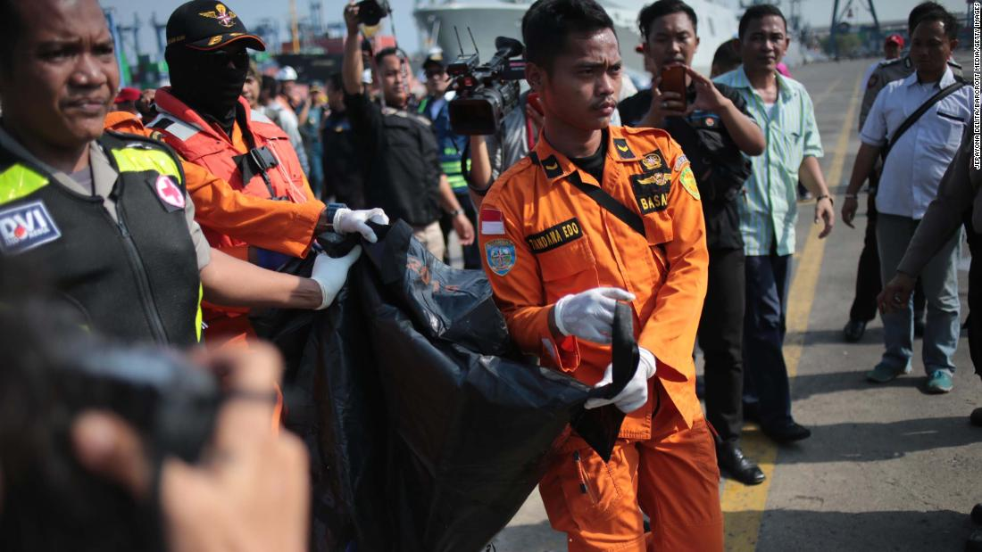 Rescue workers carry a body that was recovered from the waters near Jakarta on October 29.