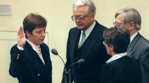 A month after being elected to the Bundestag, Merkel was appointed to Germany's Cabinet in January 1991. Chancellor Helmut Kohl named her Minister for Women and Youth.
