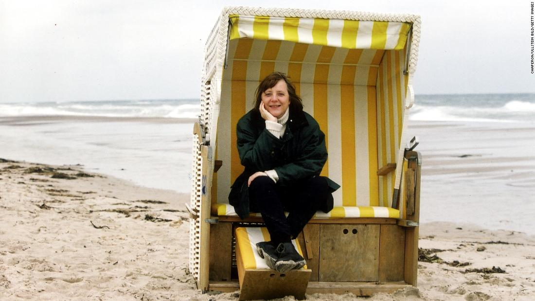 "Merkel sits in a ""strandkorb,"" or beach basket, in an undated photo. In 2000, Merkel became the Christian Democratic Union's first female chairperson. It was the opposition party at the time."