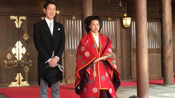 Japan's Princess Ayako and her new husband Kei Moriya speak to reporters after their marriage ceremony in the Meiji Shrine in Tokyo on October 29, 2018.